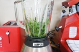 8. Add the basil to the mixer